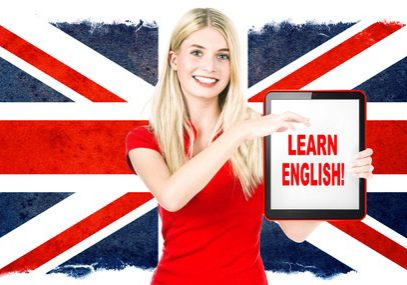 30505611 - young woman holding tablet pc on the background with british national flag  english learning concept